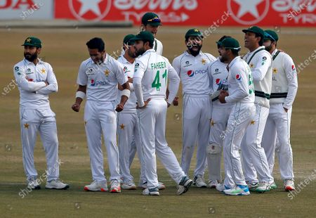 Stock Picture of Pakistan's Hasan Ali, second left, and teammates react after third umpire given LBW out to South Africa's Faf du Plessis during the fifth day of the second cricket test match between Pakistan and South Africa at the Pindi Stadium in Rawalpindi, Pakistan