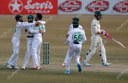 Stock Image of South Africa's Faf du Plessis, right, reacts while Pakistan's Hasan Ali, third left, celebrates with teammates after his dismissal during the fifth day of the second cricket test match between Pakistan and South Africa at the Pindi Stadium in Rawalpindi, Pakistan