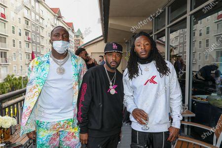 Exclusive - (L-R) Deebo Samuel, Twin and Alvin Kamara