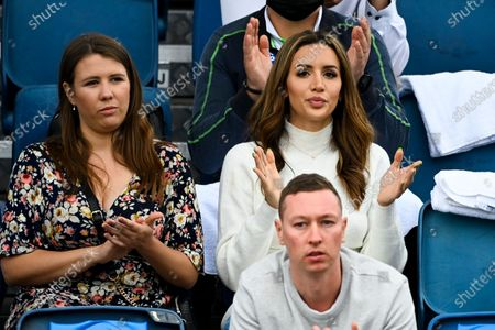 Girlfriend Vanessa Sierra (right) reacts as she observes Bernard Tomic of Australia during his first Round Men's singles match against Yuichi Sugita of Japan on Day 1 of the Australian Open Grand Slam tennis tournament at Melbourne Park in Melbourne, Australia, 08 February 2021.