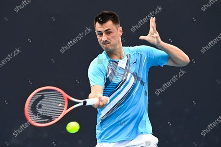 Bernard Tomic of Australia in action during his first Round Men's singles match against Yuichi Sugita of Japan on Day 1 of the Australian Open Grand Slam tennis tournament at Melbourne Park in Melbourne, Australia, 08 February 2021.