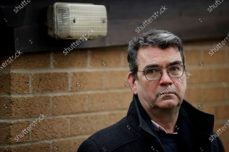 """Stock Picture of British novelist Mick Herron, the author of the Slough House espionage series, poses for photographs outside his home in Oxford, England, . Like a spy in the night, writer Mick Herron's success has been stealthy. It took a while for the world to catch up with him. A decade after he introduced a crew of flawed secret agents caught between sinister plotters and cynical spymasters in the novel """"Slow Horses,"""" Herron is a best-selling thriller writer who has been likened to John le Carré and won a coveted Golden Dagger award from the Crime Writers' Association. The seventh novel in the series, """"Slough House,"""" is out in Feb. 2021, and a TV series is in production with an A-list cast led by Gary Oldman. But initially, few took notice"""