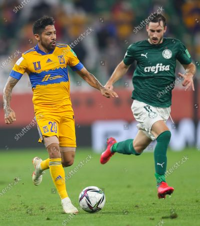 Javier Aquino (L) of Tigres UANL vies for the ball with Matias Vina of SE Palmeiras during the FIFA Club World Cup semi-final football match between Brazil's SE Palmeiras and Mexico's Tigres UANL at the Education City Stadium in Doha, Capital of Qatar, Feb. 7, 2021.