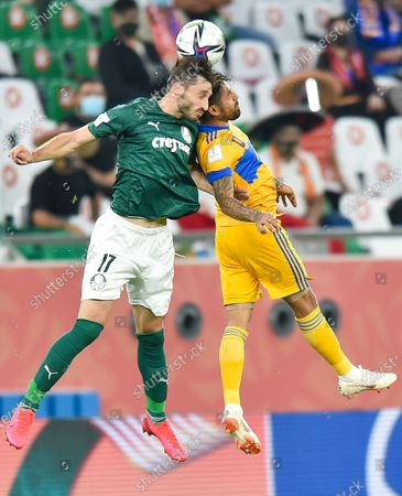 Javier Aquino (R) of Tigres UANL vies for the ball with Matias Vina of SE Palmeiras during the FIFA Club World Cup semi-final football match between Brazil's SE Palmeiras and Mexico's Tigres UANL at the Education City Stadium in Doha, Capital of Qatar, Feb. 7, 2021.