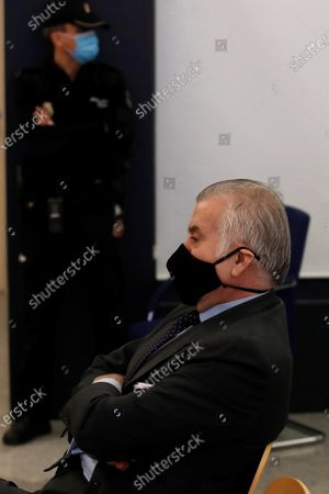 Former treasurer of Spain's Popular Party (PP) Luis Barcenas sits in the dock at the start of the first session of a trial over the Partido Popular (PP) alleged illegal funding at Spanish National Court in San Fernando de Henares, Madrid, central Spain, 08 February 2021. Barcenas, the main accused party, the previous week sent prosecutors a letter expressing his 'desire to cooperate with the justice system'. These Barcena's new revelations could affect the outcome of the trial starting on 08 February, probing an alleged illegal funding system run by the conservative group since 1982. Jose Maria Aznar and Mariano Rajoy, two former prime ministers who served at the time when the PP was allegedly running this parallel accounting system, will appear in court as witnesses.