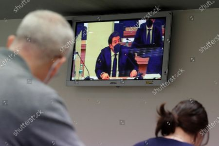 Defence lawer of former treasurer of Spain's Popular Party (PP) Luis Barcenas,Gustavo Galan, is seen on a screen at the press room during the first session of a trial over the Partido Popular (PP) alleged illegal funding. Barcenas, the main accused party, the previous week sent prosecutors a letter expressing his 'desire to cooperate with the justice system'. These Barcena's new revelations could affect the outcome of the trial starting on 08 February, probing an alleged illegal funding system run by the conservative group since 1982. Jose Maria Aznar and Mariano Rajoy, two former prime ministers who served at the time when the PP was allegedly running this parallel accounting system, will appear in court as witnesses.