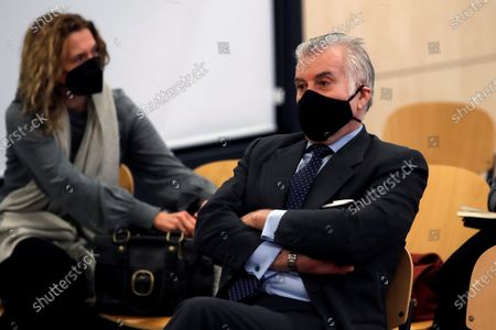 Former treasurer of Spain's Popular Party (PP) Luis Barcenas (R) sits in the dock at the start of the first session of a trial over the Partido Popular (PP) alleged illegal funding at Spanish National Court in San Fernando de Henares, Madrid, central Spain, 08 February 2021. Barcenas, the main accused party, the previous week sent prosecutors a letter expressing his 'desire to cooperate with the justice system'. These Barcena's new revelations could affect the outcome of the trial starting on 08 February, probing an alleged illegal funding system run by the conservative group since 1982. Jose Maria Aznar and Mariano Rajoy, two former prime ministers who served at the time when the PP was allegedly running this parallel accounting system, will appear in court as witnesses.