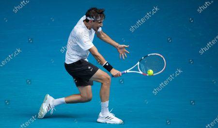 Dominic Thiem returns a shot during the men's singles first round match between Dominic Thiem of Austria and Mikhail Kukushkin of Kazakhstan in Melbourne Park, Melbourne, Australia on Feb. 8, 2021.
