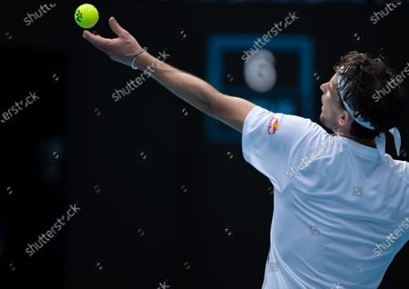 Dominic Thiem serves during the men's singles first round match between Dominic Thiem of Austria and Mikhail Kukushkin of Kazakhstan in Melbourne Park, Melbourne, Australia on Feb. 8, 2021.
