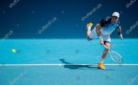 Mikhail Kukushkin returns a shot during the men's singles first round match between Dominic Thiem of Austria and Mikhail Kukushkin of Kazakhstan in Melbourne Park, Melbourne, Australia on Feb. 8, 2021.
