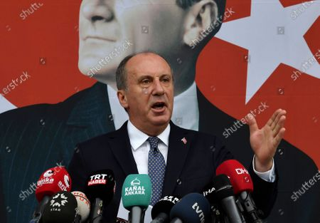 Muharrem Ince, a politician who once ran as a presidential challenger to Turkish President Recep Tayyip Erdogan, speaks in front of a poster of modern Turkey's founder, Mustafa Kemal Ataturk, during a news conference in Ankara, Turkey, . Ince resigned Monday from Turkey's main opposition party to form his own political movement. He was leaving the Republican People's Party, or CHP, citing foreign policy differences and accusing the party - which was established by Ataturk - of abandoning its founding nationalist principles