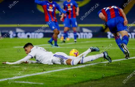 Leeds United forward Raphinha (18) is fouled by Crystal Palace defender Gary Cahill (24) who receives a yellow card and is booked during the Premier League match between Leeds United and Crystal Palace at Elland Road, Leeds