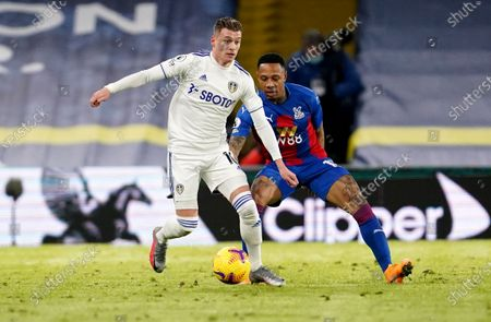 Ezgjan Alioski of Leeds (L) in action against Nathaniel Clyne of Crystal Palace (R) during the English Premier League soccer match between Leeds United and Crystal Palace in Leeds, Britain, 08 February 2021.