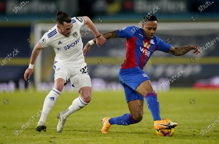 Jack Harrison of Leeds (L) in action against Nathaniel Clyne of Crystal Palace (R) during the English Premier League soccer match between Leeds United and Crystal Palace in Leeds, Britain, 08 February 2021.
