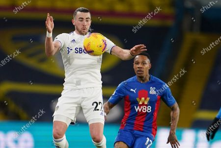 Leeds United's Jack Harrison controls the ball ahead of Crystal Palace's Nathaniel Clyne during the English Premier League soccer match between Leeds United and Crystal Palace at Elland Road Stadium in Leeds, England