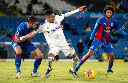 Crystal Palace's Gary Cahill, left, and Leeds United's Raphinha challenge for the ball during the English Premier League soccer match between Leeds United and Crystal Palace at Elland Road Stadium in Leeds, England