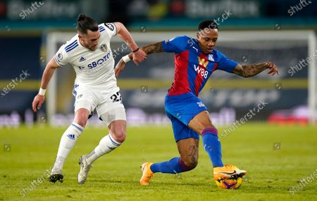 Leeds United's Jack Harrison, left, and Crystal Palace's Nathaniel Clyne challenge for the ball during the English Premier League soccer match between Leeds United and Crystal Palace at Elland Road Stadium in Leeds, England