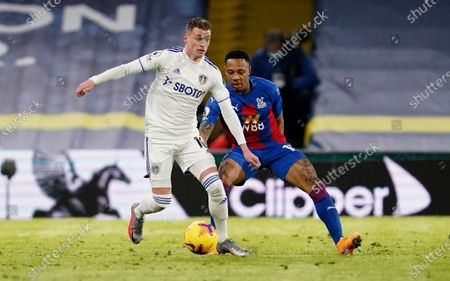 Leeds United's Ezgjan Alioski, left, and Crystal Palace's Nathaniel Clyne challenge for the ball during the English Premier League soccer match between Leeds United and Crystal Palace at Elland Road Stadium in Leeds, England