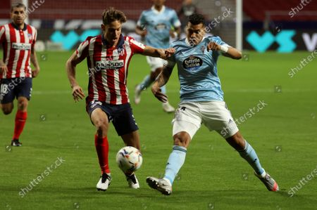 Atletico's midfielder Marcos Llorente (L) duels for the ball against Celta's defender Jeison Murillo (R) during the Spanish LaLiga soccer match between Atletico de Madrid and Real Celta de Vigo at Wanda Metropolitano in Madrid, Spain, 08 February 2021.