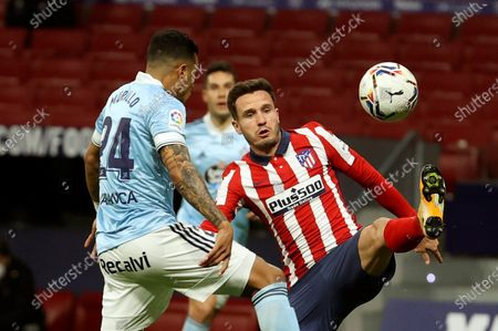 Atletico's midfielder Saul Niguez (R) duels for the ball against Celta's defender Jeison Murillo (L) during the Spanish LaLiga soccer match between Atletico de Madrid and Real Celta de Vigo at Wanda Metropolitano in Madrid, Spain, 08 February 2021.