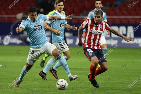 Atletico's striker Angel Correa (R) duels for the ball against Celta's defender Jeison Murillo (L) during the Spanish LaLiga soccer match between Atletico de Madrid and Real Celta de Vigo at Wanda Metropolitano in Madrid, Spain, 08 February 2021.