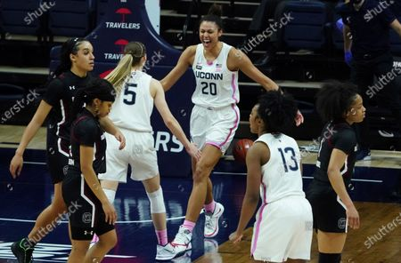 Stock Photo of Connecticut forward Olivia Nelson-Ododa (20) and guard Paige Bueckers (5) react after defeating South Carolina in overtime of an NCAA college basketball game in Storrs, Conn