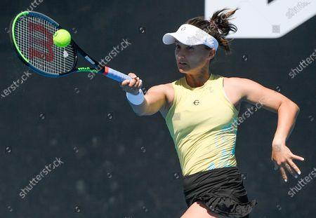 United States' Lauren Davis makes a forehand return to Switzerland's Belinda Bencic during their first round match at the Australian Open tennis championship in Melbourne, Australia