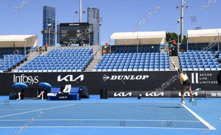United States' Lauren Davis serves to Switzerland's Belinda Bencic during their first round match at the Australian Open tennis championship in Melbourne, Australia