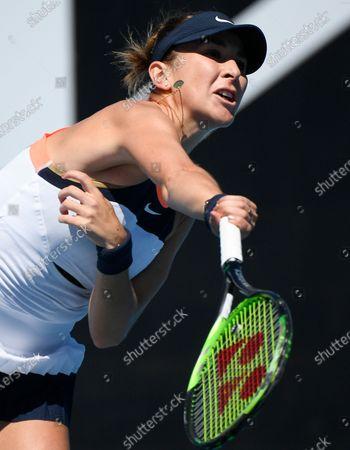Switzerland's Belinda Bencic serves to against United States' Lauren Davis during their first round match at the Australian Open tennis championship in Melbourne, Australia