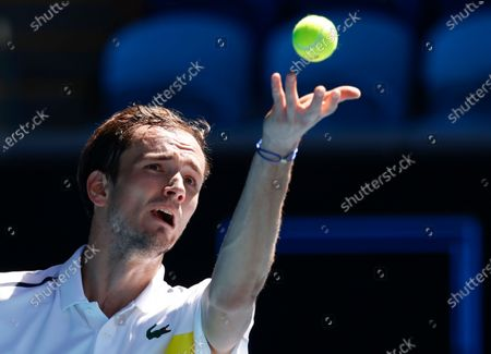 Russia's Daniil Medvedev serves to Canada's Vasek Pospisil during their first round match at the Australian Open tennis championship in Melbourne, Australia