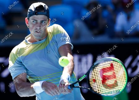 Canada's Vasek Pospisil makes a backhand return to Russia's Daniil Medvedev during their first round match at the Australian Open tennis championship in Melbourne, Australia