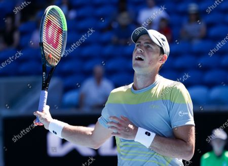 Canada's Vasek Pospisil reacts during his first round match against Russia's Daniil Medvedev at the Australian Open tennis championship in Melbourne, Australia
