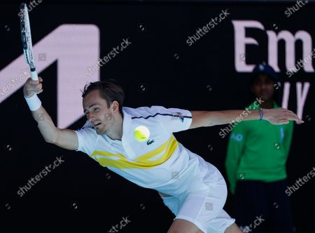 Russia's Daniil Medvedev makes a forehand return to Canada's Vasek Pospisil during their first round match at the Australian Open tennis championship in Melbourne, Australia