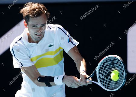 Russia's Daniil Medvedev makes a backhand return to Canada's Vasek Pospisil during their first round match at the Australian Open tennis championship in Melbourne, Australia