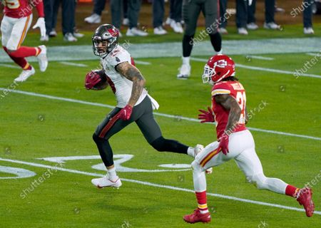 Tampa Bay Buccaneers wide receiver Mike Evans (13) gains yards during the first half of the NFL Super Bowl 55 football game against the Kansas City Chiefs, in Tampa, Fla