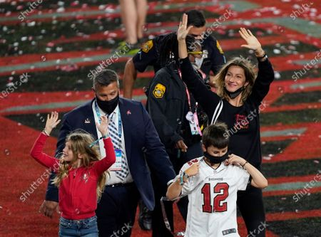 Stock Image of Gisele Bundchen, wife of Tampa Bay Buccaneers quarterback Tom Brady, walks off the field after the NFL Super Bowl 55 football game against the Kansas City Chiefs, in Tampa, Fla