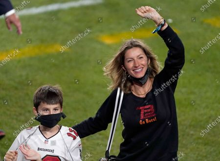 Gisele Bundchen, wife of Tampa Bay Buccaneers quarterback Tom Brady, walks off the field after the NFL Super Bowl 55 football game against the Kansas City Chiefs, in Tampa, Fla