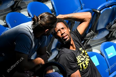 Stock Image of Boyfriend Gael Monfils of France sits in the players box of Elina Svitolina of Ukraine during her first round women's singles match against Marie Bouzkova of the Czech Republic during the Australian Open tennis tournament at Melbourne Park in Melbourne, Australia, 09 February 2021.