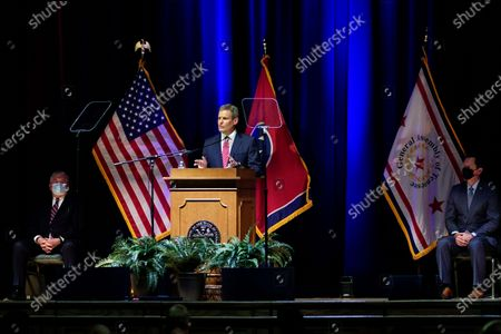 Tennessee Gov. Bill Lee delivers his State of the State Address in War Memorial Auditorium, in Nashville, Tenn. At left is Lt. Gov. Randy McNally, R-Oak Ridge, and at right is Rep. Cameron Sexton, R-Crossville