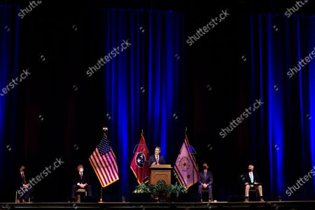 Tennessee Gov. Bill Lee, center, delivers his State of the State Address in War Memorial Auditorium, in Nashville, Tenn