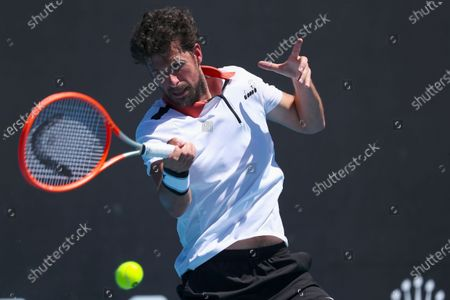 Robin Haase of Netherlands in action against Filip Krajinovic of Serbia their first round men's singles match of the Australian Open tennis tournament at Melbourne Park in Melbourne, Australia, 09 February 2021.