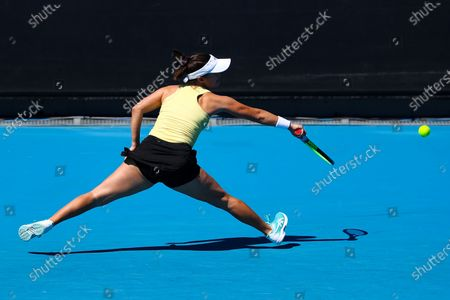 Lauren Davis of the USA in action against Belinda Bencic of Switzerland during their first round women's singles match of the Australian Open tennis tournament at Melbourne Park in Melbourne, Australia, 09 February 2021.