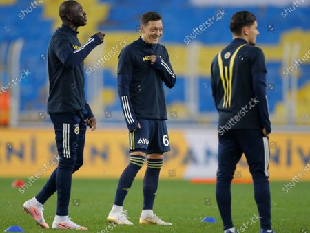 Stock Photo of Mesut Ozil, center, the former Germany soccer midfielder, smiles during warm up prior to a Turkish Super League soccer match between Fenerbahce and Galatasaray in Istanbul, . Ozil, who is of Turkish descent and was formerly with Arsenal had signed with Fenerbahce soccer club