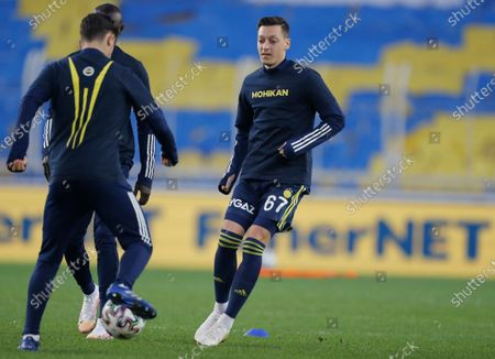 Stock Picture of Mesut Ozil, center, the former Germany soccer midfielder, smiles during warm up prior to a Turkish Super League soccer match between Fenerbahce and Galatasaray in Istanbul, . Ozil, who is of Turkish descent and was formerly with Arsenal had signed with Fenerbahce soccer club