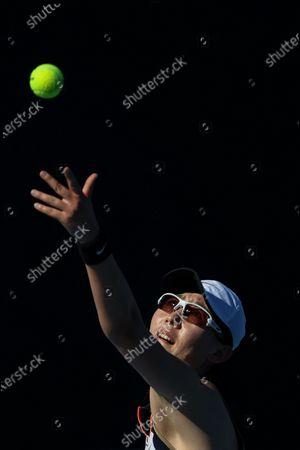 Zheng Saisai of China serves during the women's singles first round match between Barbora Krejcikova of Czech Republic and Zheng Saisai of China at the Australian Open in Melbourne Park, Melbourne, Australia on Feb. 9, 2021.