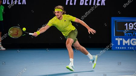 Greece's Stefanos Tsitsipas makes a forehand return to France's Gilles Simon during their first round match at the Australian Open tennis championship in Melbourne, Australia