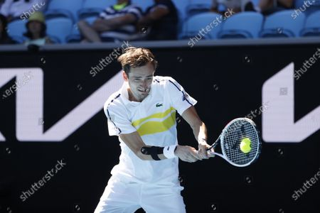 Stock Image of Russia's Daniil Medvedev makes a backhand return to Canada's Vasek Pospisil during their first round match at the Australian Open tennis championship in Melbourne, Australia