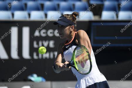 Switzerland's Belinda Bencic makes a backhand return to United States' Lauren Davis during their match at the Australian Open Tennis championships in Melbourne, Australia