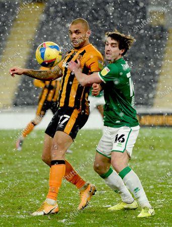 Josh Magennis of Hull City and Joe Walsh of Lincoln City