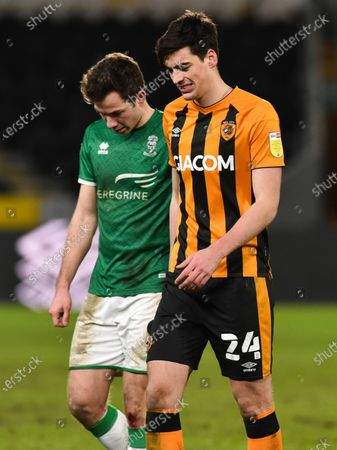 Jacob Greaves of Hull City and Tom Hopper of Lincoln City at the end of the game